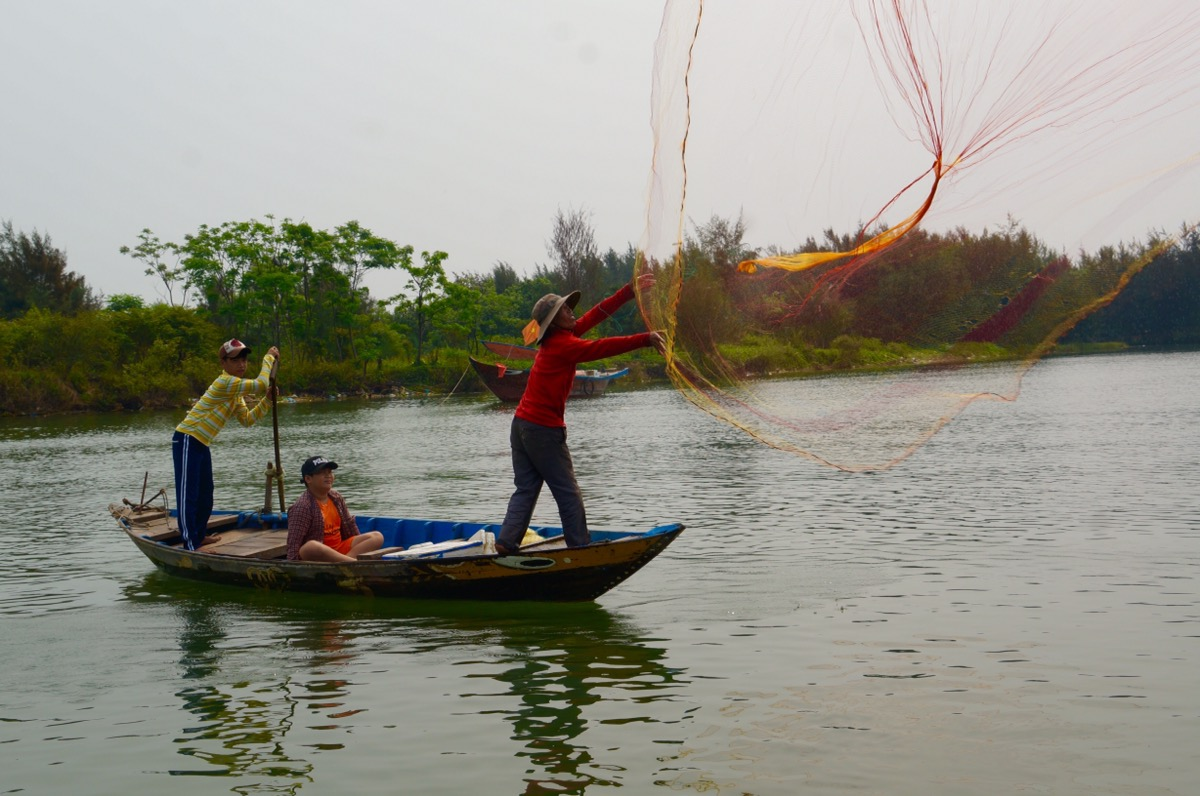 A fisherman casting his net